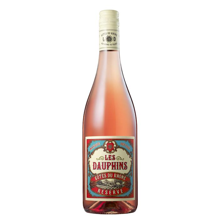 """Though it bears the rosy hue more commonly associated with the Côtes de Provence, <a href=""""http://www.lesdauphins-rhone.com/"""" rel=""""nofollow noopener"""" target=""""_blank"""" data-ylk=""""slk:Les Dauphins"""" class=""""link rapid-noclick-resp"""">Les Dauphins</a>' rosé hails from the Rhône valley. The vineyard enlisted graphic designer <a href=""""http://www.amphora.co.uk/"""" rel=""""nofollow noopener"""" target=""""_blank"""" data-ylk=""""slk:Neil Tully"""" class=""""link rapid-noclick-resp"""">Neil Tully</a>—who is also a certified Master of Wine—to create its whimsical label, which draws aesthetic cues from both France's rich wine history and the retro <a href=""""https://www.architecturaldigest.com/gallery/posters-slideshow?mbid=synd_yahoo_rss"""" rel=""""nofollow noopener"""" target=""""_blank"""" data-ylk=""""slk:posters"""" class=""""link rapid-noclick-resp"""">posters</a> of the Jazz Age. $12, Vivino. <a href=""""https://www.vivino.com/fr-les-dauphins-cotes-du-rhone-reserve-rose/w/3645677"""" rel=""""nofollow noopener"""" target=""""_blank"""" data-ylk=""""slk:Get it now!"""" class=""""link rapid-noclick-resp"""">Get it now!</a>"""