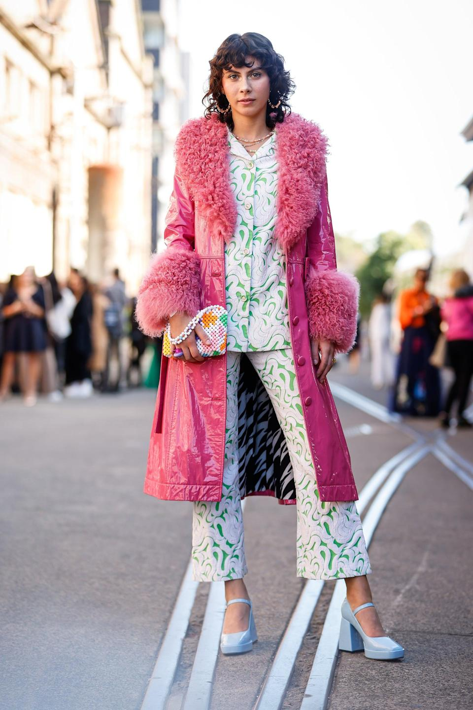 """This look is every viral Instagram trend in one.<br><br><em>Zoe Tapp wearing a <a href=""""https://www.ssense.com/en-us/women/product/saks-potts/pink-foxy-coat/5110771"""" rel=""""nofollow noopener"""" target=""""_blank"""" data-ylk=""""slk:Saks Potts jacket"""" class=""""link rapid-noclick-resp"""">Saks Potts jacket</a>, a <a href=""""https://www.susanalexandra.com/collections/bags/products/trippy-moo-bag"""" rel=""""nofollow noopener"""" target=""""_blank"""" data-ylk=""""slk:Susan Alexandra bag"""" class=""""link rapid-noclick-resp"""">Susan Alexandra bag</a>, and <a href=""""https://lamanso.shop/products/fluordreaaaam"""" rel=""""nofollow noopener"""" target=""""_blank"""" data-ylk=""""slk:La Manso rings"""" class=""""link rapid-noclick-resp"""">La Manso rings</a>.</em><span class=""""copyright"""">Photo: Hanna Lassen/Getty Images.</span>"""