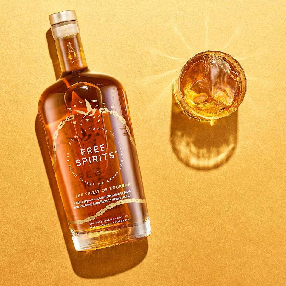 """<p>Free Spirits' take on bourbon has the rich, oaky palate that you know and love, but without the headache. This bourbon alternative features hints of caramel and a malty, brown sugar finish. </p> <p><strong>Buy It!</strong> $37, <a href=""""https://drinkfreespirits.com/products/the-spirit-of-bourbon"""" rel=""""nofollow noopener"""" target=""""_blank"""" data-ylk=""""slk:drinkfreespirits.com"""" class=""""link rapid-noclick-resp"""">drinkfreespirits.com</a></p>"""