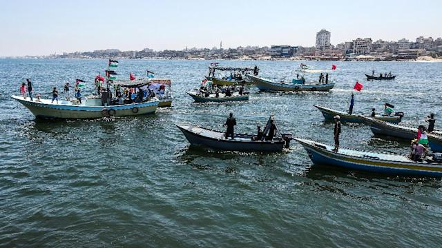 Activists escort a boat carrying wounded Palestinians from Gaza in a bid to challenge an Israeli blockade of the enclave on July 10, 2018 (AFP Photo/MAHMUD HAMS)