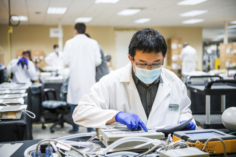 FILE - In this March 28, 2020, file photo, James Nguyen, a fuel cell stack testing engineer, tests ventilator oxygen at Bloom Energy in Sunnyvale, Calif. Bloom Energy is a fuel cell generator company that has switched over to refurbishing ventilators as an increasing number of patients experience respiratory issues as a result of COVID-19. California Gov. Gavin Newsom announced Monday, April 6, 2020, the state would loan 500 ventilators to the national stockpile for use by New York and other states experiencing a crush of coronavirus-related hospitalizations. (Beth LaBerge/Pool Photo via AP, File)