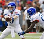 Boise State quarterback Grant Hedrick (9) hands off the football to his teammate running back Jay Ajayi (27) in the second quarter of the Hawaii Bowl NCAA college football game against Oregon State, in Honolulu, Tuesday, Dec. 24, 2013. (AP Photo/Eugene Tanner)