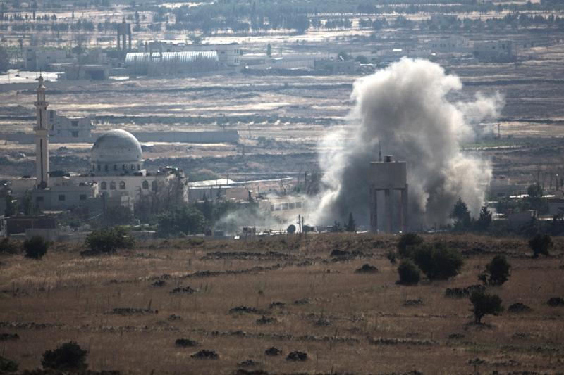 A view from the Golan Heights shows smoke rising following explosions in a village in Syria's Quneitra province, on June 17, 2015 (AFP Photo/Menahem Kahana)