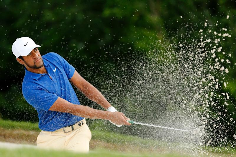 Tony Finau blasts out of a bunker en route to the early lead at the Charles Schwab Challenge in Texas