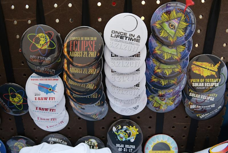 Eclipse pins are seen for sale on a street near the City Market in Charleston, South Carolina, on August 20, 2017 (AFP Photo/MANDEL NGAN)