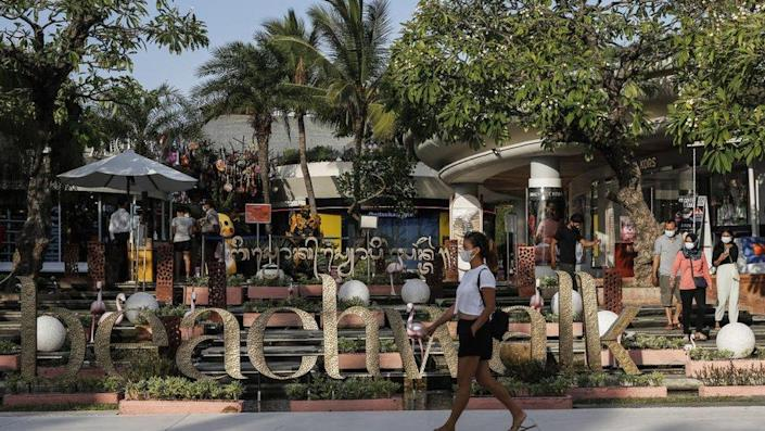 Visitors wear protective mask at Beach Walk Mall during Covid-19 restriction relaxation