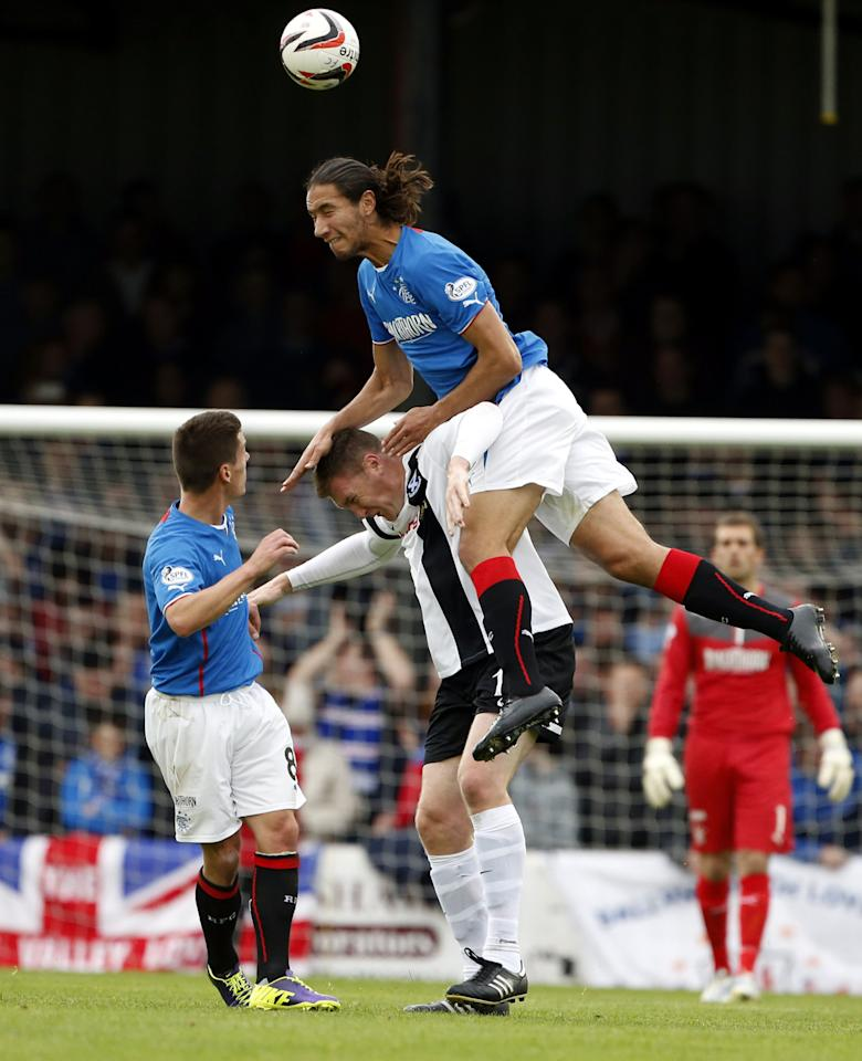 Rangers' Belil Mohsni (top) and Ayr United's Kevin Kyle fight for the ball during the Scottish League One match at Somerset Park, Ayr.