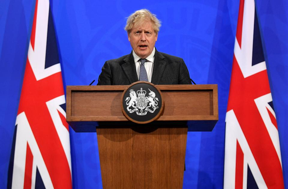 Britain's Prime Minister Boris Johnson gives an update on the coronavirus Covid-19 pandemic during a virtual press conference inside the new Downing Street Briefing Room in central London on April 20, 2021. - Britain on Monday imposed its strictest travel curbs on India after an explosion of coronavirus cases there, hours after Prime Minister Boris Johnson called off a trip to New Delhi. (Photo by TOBY MELVILLE / POOL / AFP) (Photo by TOBY MELVILLE/POOL/AFP via Getty Images)