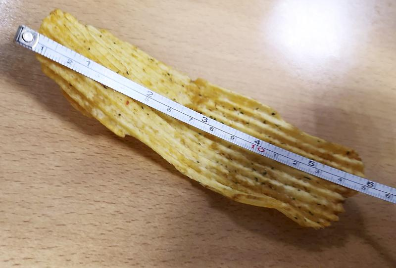 A man has found a crisp that is six inches long (Picture: SWNS)