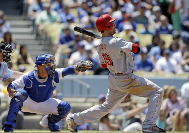 Cincinnati Reds' Joey Votto leans way back from a called third strike pitch from starter Chris Capuano to catcher Tim Federowicz in the fourth inning of a baseball game in Los Angeles, Sunday, July 28, 2013. (AP Photo/Reed Saxon)