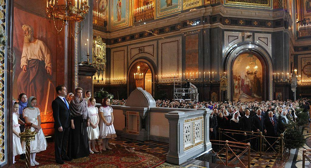 RUSSIA: Russian Prime Minister Dmitry Medvedev (4th L) attends a Christmas service with his wife Svetlana in the Cathedral of Christ the Saviour in Moscow January 7, 2013.