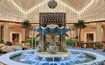 """<p>This salmon and mint-colored Michael Graves structure is impossible to miss, yet it remains one of the greatest under-the-radar Disney resorts. That's because the <a href=""""https://www.swandolphin.com"""" rel=""""nofollow noopener"""" target=""""_blank"""" data-ylk=""""slk:Walt Disney World Swan & Dolphin Resort"""" class=""""link rapid-noclick-resp"""">Walt Disney World Swan & Dolphin Resort</a>, which participates in the <a href=""""https://www.travelandleisure.com/hotels-resorts/how-to-get-the-most-out-of-marriott-bonvoy-points"""" rel=""""nofollow noopener"""" target=""""_blank"""" data-ylk=""""slk:Marriott Bonvoy rewards program"""" class=""""link rapid-noclick-resp"""">Marriott Bonvoy rewards program</a>, can often be more budget-friendly than Walt Disney World's own hotels while offering identical theme park transportation and key benefits, including Extra Magic Hours, extended Fastpass+ booking, and complimentary parking at all 4 parks. With a walking path to both Epcot and Disney's Hollywood Studios, <a href=""""https://www.travelandleisure.com/trip-ideas/disney-vacations/disney-world-secret-swan-dolphin-food-festival"""" rel=""""nofollow noopener"""" target=""""_blank"""" data-ylk=""""slk:its very own food festival"""" class=""""link rapid-noclick-resp"""">its very own food festival</a>, and dining options including Shula's Steak House, Il Mulino, and two newly-opened grab-and-go markets, it's remarkable that this hotel offers guests the best of Disney World for hundreds less than other on-property resorts. </p>"""
