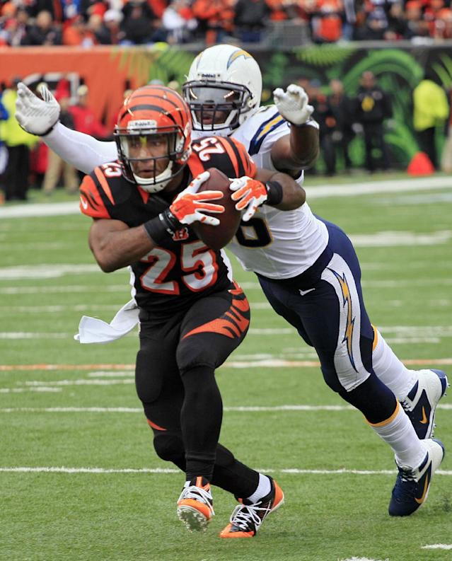 San Diego Chargers linebacker Donald Butler, right, chases down Cincinnati Bengals running back Giovani Bernard in the first half of an NFL wild-card playoff football game on Sunday, Jan. 5, 2014, in Cincinnati. Bernard fumbled on the play and the Chargers recovered the ball. (AP Photo/Tom Uhlman)