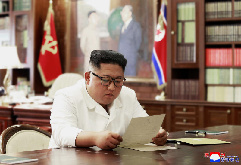 "In this undated file photo provided on Sunday, June 23, 2019, by the North Korean government, North Korean leader Kim Jong Un reads a letter from U.S. President Donald Trump. South Korea's President Moon Jae-in on Tuesday, June 25, 2019, said North Korean and U.S. officials are holding ""behind-the-scenes talks"" to set up a third summit between the countries' leaders. Korean language watermark on image as provided by source reads: ""KCNA"" which is the abbreviation for Korean Central News Agency. (Korean Central News Agency/Korea News Service via AP, File)"