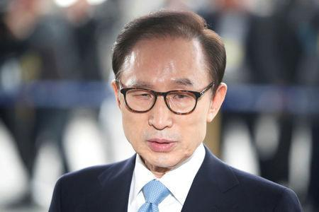 South Korea's former president Lee Myung-bak arrives at the prosecutors' office in Seoul, South Korea, March 14, 2018. REUTERS/Kim Hong-Ji/Pool TPX IMAGES OF THE DAY