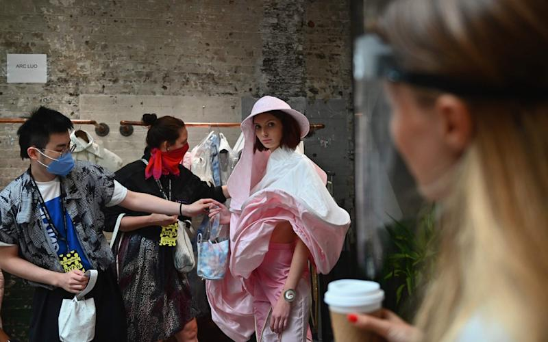 A model gets fitted during a NYFW behind the scenes fitting day for the Flying Solo runway show featuring a collective of local designers on September 11 - ANGELA WEISS/AFP