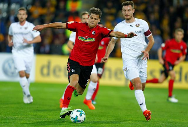 Soccer Football - DFB Cup Second Round - SC Freiburg v Dynamo Dresden - Dreisamstadion, Freiburg, Germany - October 25, 2017 SC Freiburg's Florian Niederlechner in action with Dynamo Dresden's Florian Ballas REUTERS/Ralph Orlowski DFB RULES PROHIBIT USE IN MMS SERVICES VIA HANDHELD DEVICES UNTIL TWO HOURS AFTER A MATCH AND ANY USAGE ON INTERNET OR ONLINE MEDIA SIMULATING VIDEO FOOTAGE DURING THE MATCH.