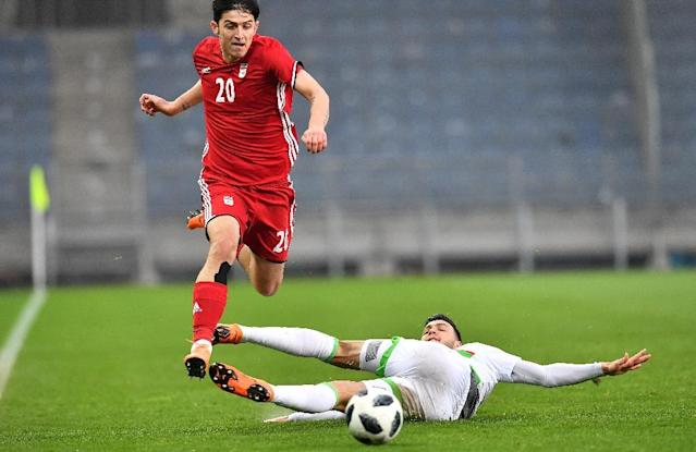 Iran's Sardar Azmoun tunes up for the World Cup in a friendly against Algeria (AFP Photo/JOE KLAMAR)