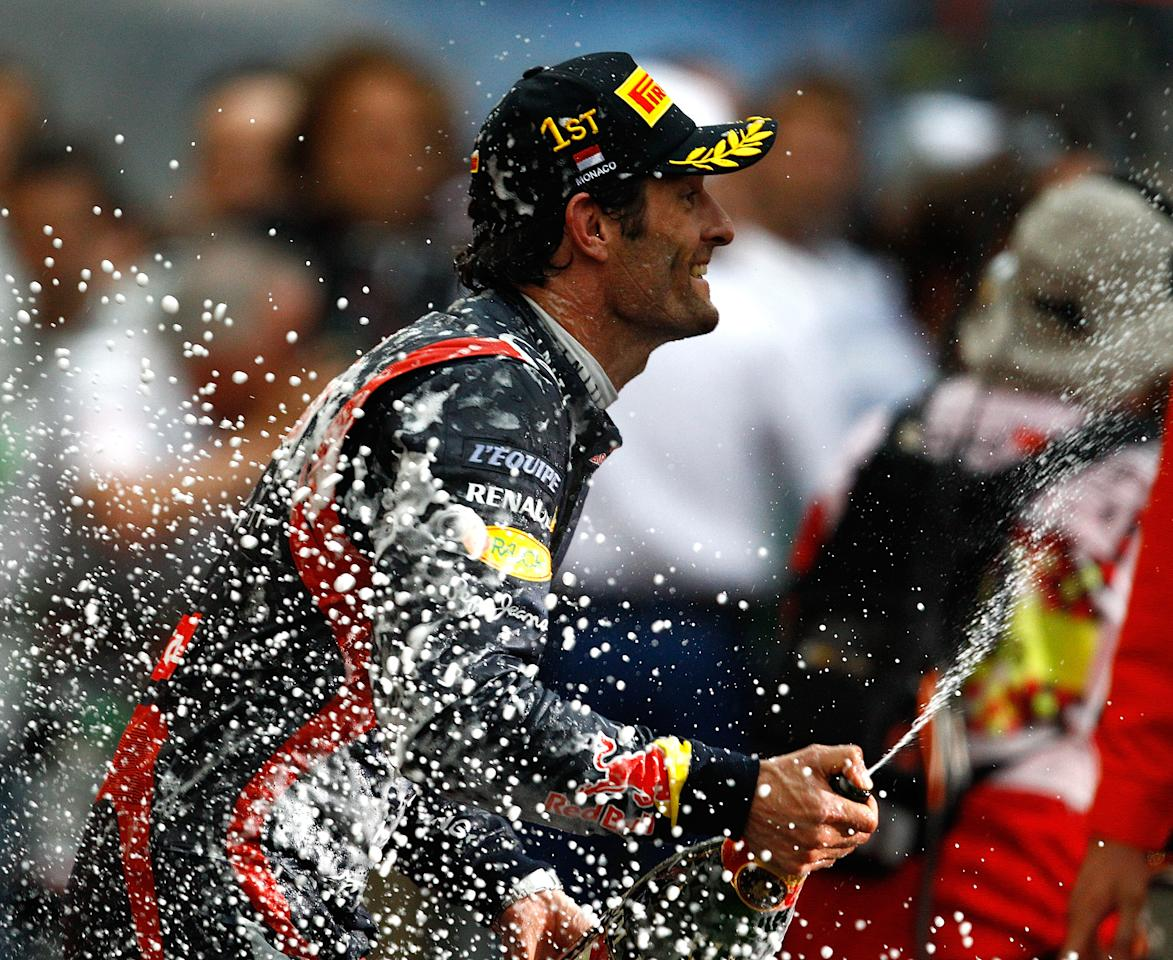 MONTE CARLO, MONACO - MAY 27:  Mark Webber of Australia and Red Bull Racing celebrates after winning the Monaco Formula One Grand Prix at the Circuit de Monaco on May 27, 2012 in Monte Carlo, Monaco.  (Photo by Vladimir Rys Photography via Getty Images)