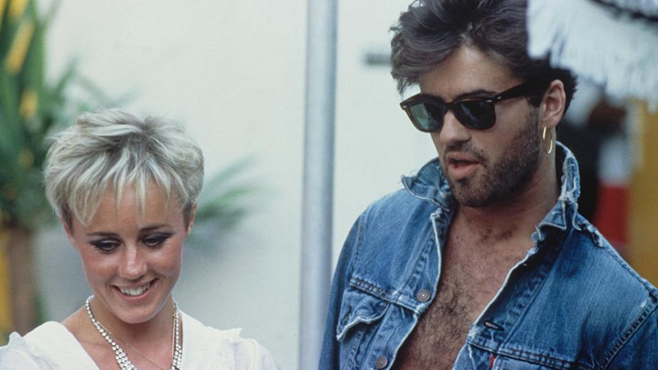 George Michael, pictured together with Shirlie Holliman backstage prior to performing at their farewell concert, entitled 'The Final' at Wembley Stadium in London on 28th June 1986.