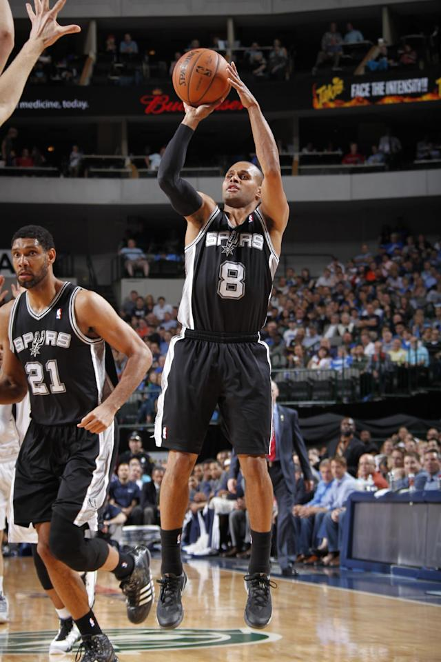 DALLAS, TX - APRIL 10: Patty Mills #8 of the San Antonio Spurs shoots against the Dallas Mavericks on April 10, 2014 at the American Airlines Center in Dallas, Texas. (Photo by Glenn James/NBAE via Getty Images)