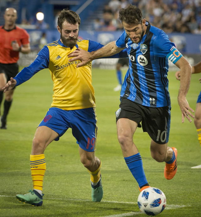 Montreal Impact's Ignacio Piatti fights off Colorado Rapids Jack Price, left, during the second half of an Major League Soccer match Saturday, July 7, 2018, in Montreal. (Peter McCabe/The Canadian Press via AP)