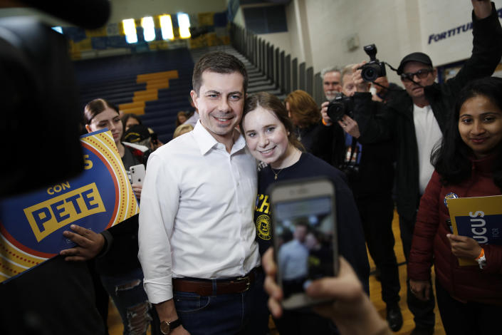 Democratic presidential candidate former South Bend, Ind., Mayor Pete Buttigieg poses for a photo as he visits a caucus site Saturday, Feb. 22, 2020, in Las Vegas. (AP Photo/John Locher)