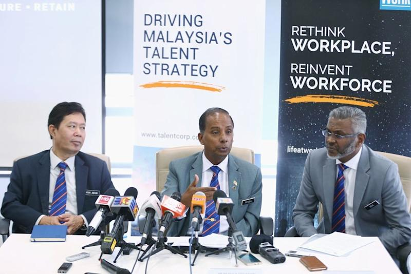 Human Resources Minister M. Kulasegaran (centre) speaks to reporters during a visit to TalentCorp's office in Kota Damansara January 23, 2019. — Picture by Ahmad Zamzahuri