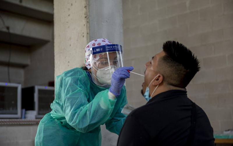 A health worker performs a coronavirus test to a local resident in Spain - Pablo Blazquez Dominguez/Getty