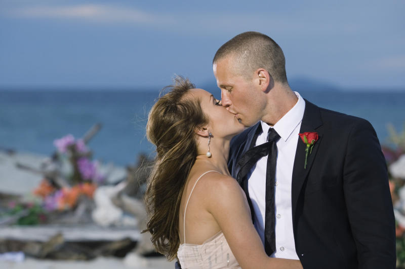"FILE - In this publicity file photo provided by ABC, ""Bachelorette"" Ashley Hebert kisses J.P. Rosenbaum on the season finale of ""The Bachelorette"" in Fiji. Hebert chose the 34-year-old construction manager over winemaker Ben Flajnik from California in Monday's two-hour finale. ""The Bachelorette: Ashley and J.P.'s Wedding"" will air in December 2012 and show everything from Hebert's dress fitting to wedding planning to their bachelor and bachelorette parties. (AP Photo/ABC, Matt Klitscher, File)"