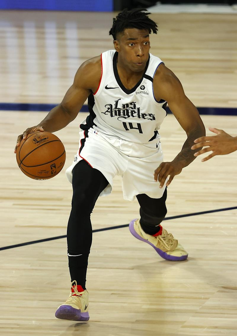 The Clippers' Terance Mann drives against the Thunder on Aug. 14, 2020.