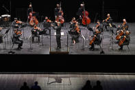 CORRECTS SPELLING OF FIRST NAME TO ESA INSTEAD OF ESSA - Esa-Pekka Salonen, center, music director of the San Francisco Symphony and principal conductor of London's Philharmonia Orchestra, leads the New York Philharmonic before an audience of 150 concertgoers at The Shed in Hudson Yards, Wednesday, April 14, 2021, in New York. It was the first time since March 10, 2020, that the entire orchestra performed together in front of a live audience. (AP Photo/Kathy Willens)