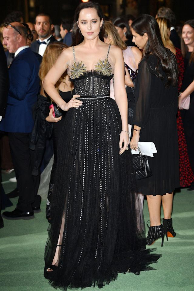 <p>Dakota Johnson opted for a black embellished Gucci<span> dress.</span><span></span></p>
