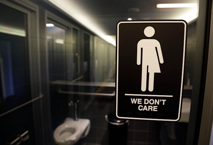 A sign outside a restroom in Durham, North Carolina. A state law requiring people to use the restroom or locker room corresponding with their sex at birth, drew widespread criticism. The law was later repealed.