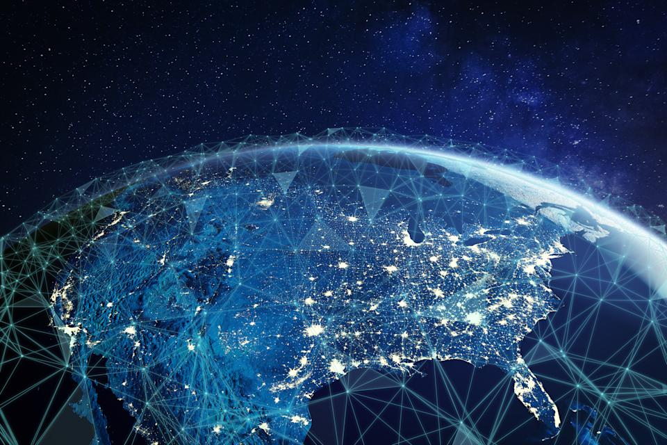 Telecommunication network above North America and United States viewed from space for American 5g LTE mobile web, global WiFi connection, Internet of Things (IoT) technology or blockchain fintech. Some elements from NASA (https://eoimages.gsfc.nasa.gov/images/imagerecords/57000/57752/land_shallow_topo_2048.jpg)