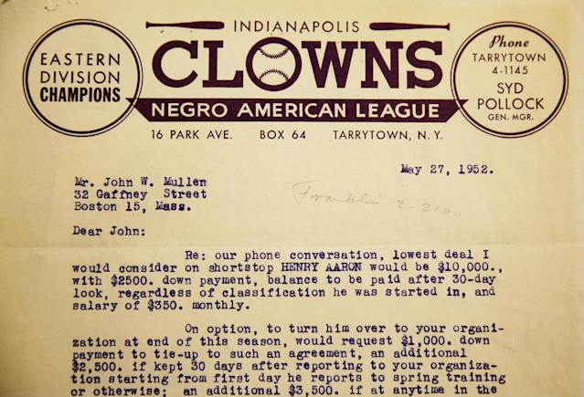 A letter negotiating Hank Aaron's contract from 1952 is seen as part of Emory University's collection, Monday, April 7, 2014, in Atlanta. Three Emory University baseball players teamed up last year to dig through the collection, donated in 2013 by a former scout for the Atlanta Braves, to create an exhibit opening April 24 at the university's Robert W. Woodruff Library. (AP Photo/David Goldman)