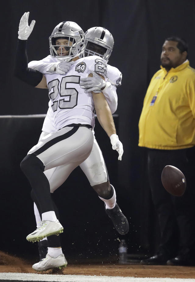 Oakland Raiders free safety Erik Harris (25) celebrates with Karl Joseph after scoring on an interception return against the Los Angeles Chargers during the first half of an NFL football game in Oakland, Calif., Thursday, Nov. 7, 2019. (AP Photo/Ben Margot)