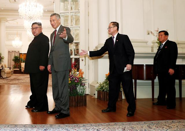 <p>President Donald Trump is met by Singapore's Foreign Minister Vivian Balakrishnan and other officials after arriving in Singapore June 10, 2018. (Photo: Ministry of Communications and Information, Singapore via Reuters) </p>