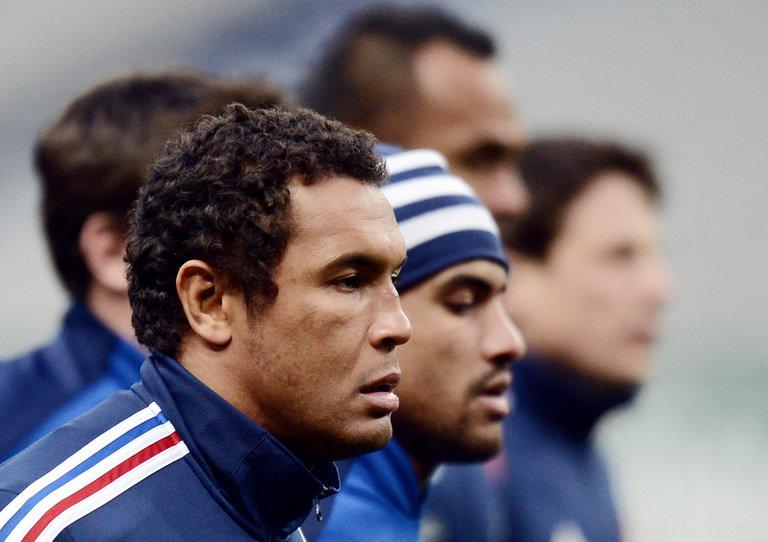 France rugby captain Thierry Dusautoir limbers up during a training session on February 8, 2013