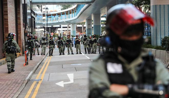 Police officers guard the perimeter around Polytechnic University. Photo: Sam Tsang