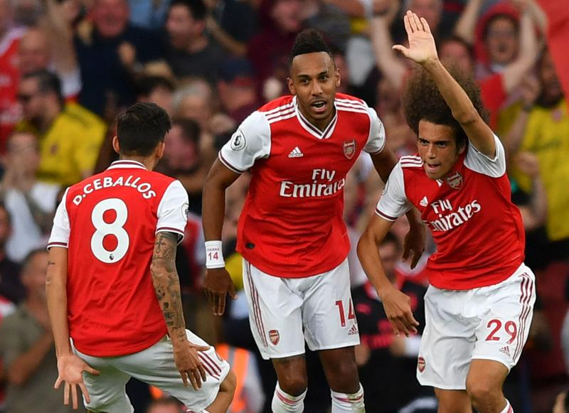 Gabonese striker Aubameyang (centre) rescued a point for Arsenal. (Photo credit BEN STANSALL/AFP/Getty Images)