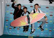 Keaton Stromberg, from left, Drew Chadwick and Wesley Stromberg of the musical group Emblem3 pose backstage with the award for choice music breakout group at the Teen Choice Awards at the Gibson Amphitheater on Sunday, Aug. 11, 2013, in Los Angeles. (Photo by Jordan Strauss/Invision/AP)