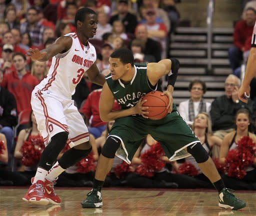 Chicago State's Clarke Rosenberg, right, looks for an open pass as Ohio State's Shannon Scott defends during the second half of an NCAA college basketball game on Saturday, Dec. 29, 2012, in Columbus, Ohio. Ohio State defeated Chicago State 87-44. (AP Photo/Jay LaPrete)