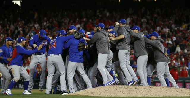 The Chicago Cubs celebrate after beating the Washington Nationals 9-8 to advance to the NLCS. (AP)