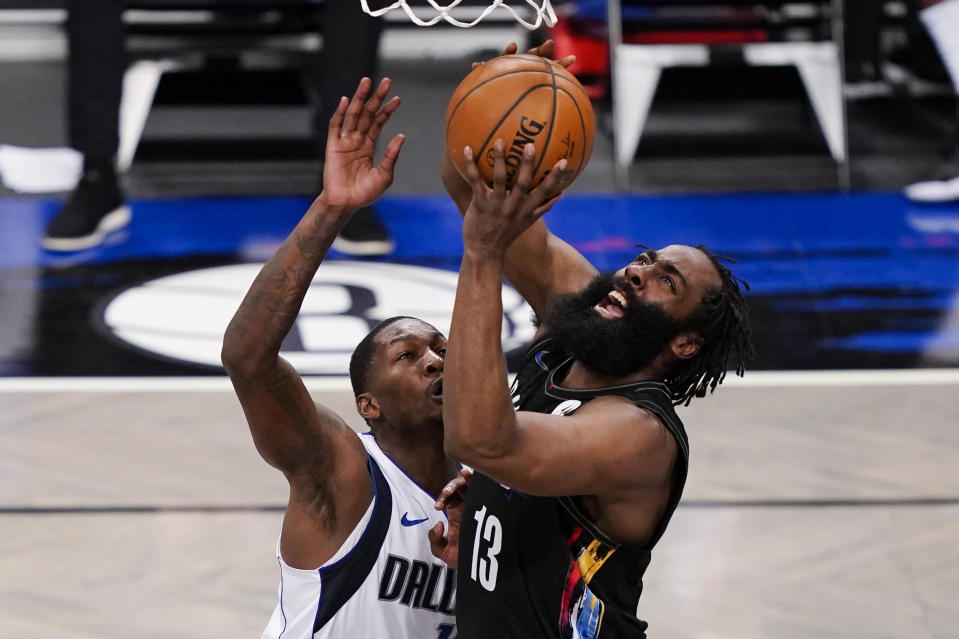 Brooklyn Nets guard James Harden (13) shoots against Dallas Mavericks forward Dorian Finney-Smith during during the second half of an NBA basketball game Saturday, Feb. 27, 2021, in New York. (AP Photo/John Minchillo)