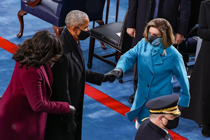 <p>The Obamas share a gloved greeting with Speaker of the House Nancy Pelosi. </p>