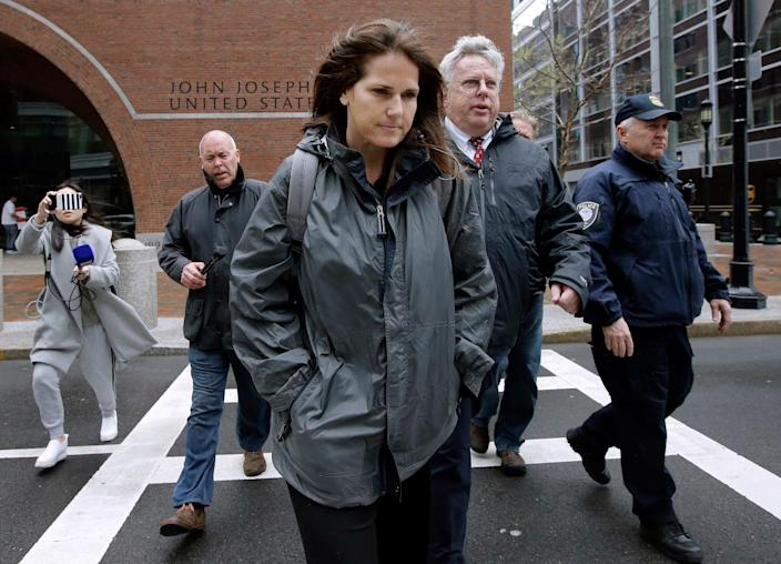 Former University of Southern California soccer coach Laura Janke departs federal court, Tuesday, May 14, 2019, in Boston, where she pleaded guilty to charges in a nationwide college admissions bribery scandal. (AP Photo/Steven Senne) ORG XMIT: BX104