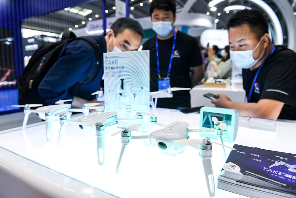 Visitors learn about drones at the 22nd China Hi-Tech Fair (CHTF) held in Shenzhen, south China's Guangdong Province, Nov. 11, 2020. Photo: Xinhua/Mao Siqian via Getty Images