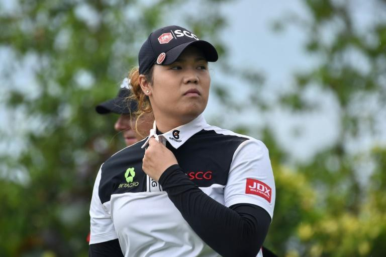 Ariya Jutanugarn of Thailand walks along the fairway during the HSBC Women's Champions golf tournament, at the Sentosa Golf Club in Singapore, on March 3, 2017