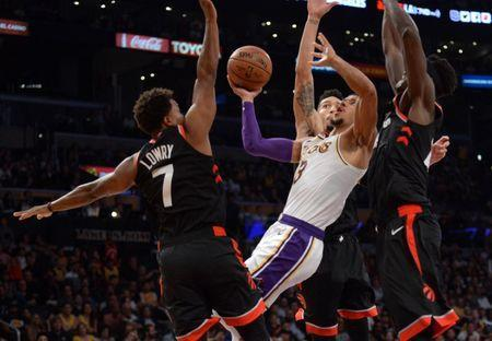 November 4, 2018; Los Angeles, CA, USA; Los Angeles Lakers guard Josh Hart (3) moves to the basket against Toronto Raptors guard Kyle Lowry (7) guard Danny Green (14) and forward Pascal Siakam (43) during the second half at Staples Center. Mandatory Credit: Gary A. Vasquez-USA TODAY Sports